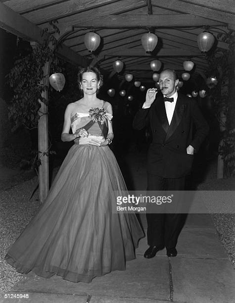 1952 American tobacco heiress Doris Duke Cromwell poses with Franz Bueb who smokes a cigarette in a holder at the Belmont Ball in Belmont Park New...