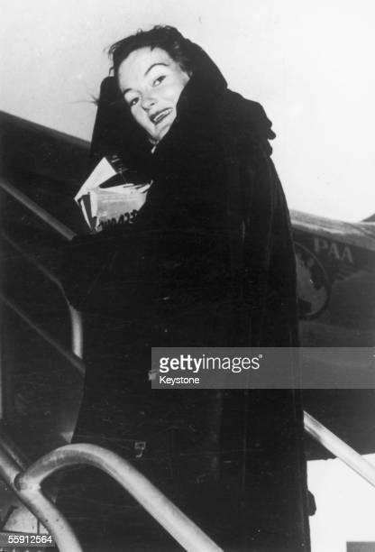 American tobacco heiress socialite and Harper's bazaar fashion editor Doris Duke boards a Pan American flight to Paris April 1947