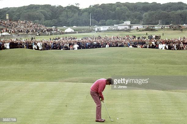 American tour golfer Doug Sanders famous for his putting ability attempting a short putt across the 'Valley of Sin' at the 18th hole at St Andrews...