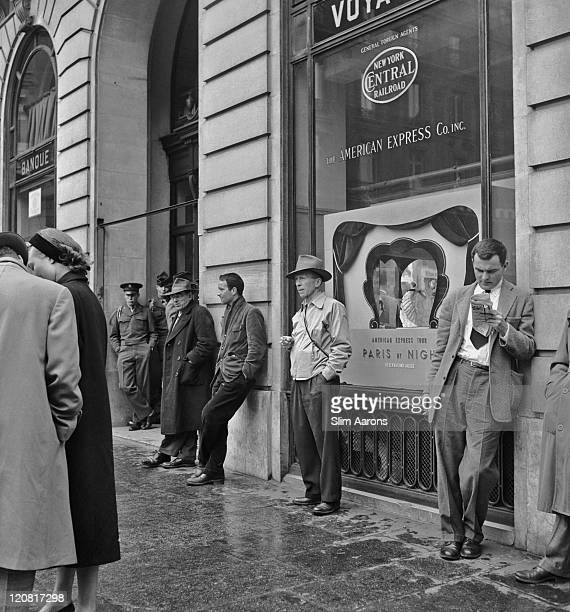 American tourists including GI's outside the American Express office in Paris circa 1949