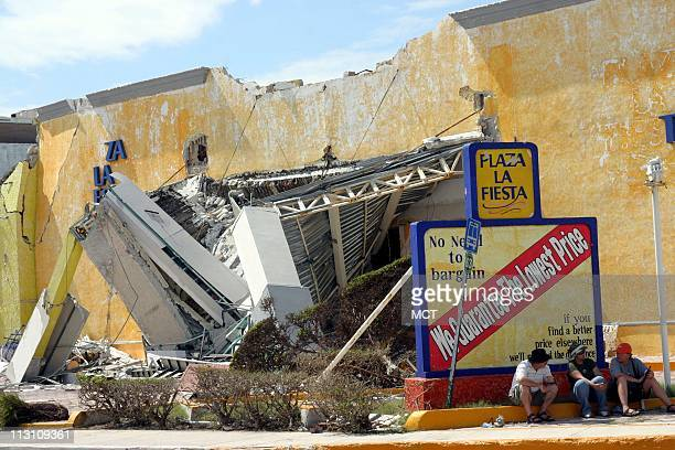 CANCUN MEXICO American tourists linger outside a destroyed shopping mall in Cancun Mexico October 26 six days after Hurricane Wilma hit the region