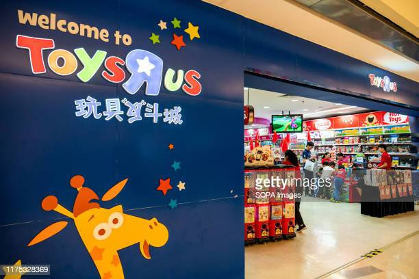 """American toy, clothing, video game, and baby product retailer Toys """"R"""" Us store and logo seen in Shenzhen."""