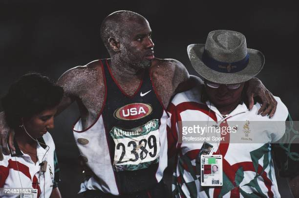 American track and field athlete and world record holder Mike Powell pictured being assisted by race officials during competition for the United...