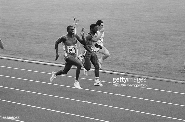 American track and field athlete Carl Lewis competes to cross the finish line in first place to win the gold medal in the final of the men's 100...