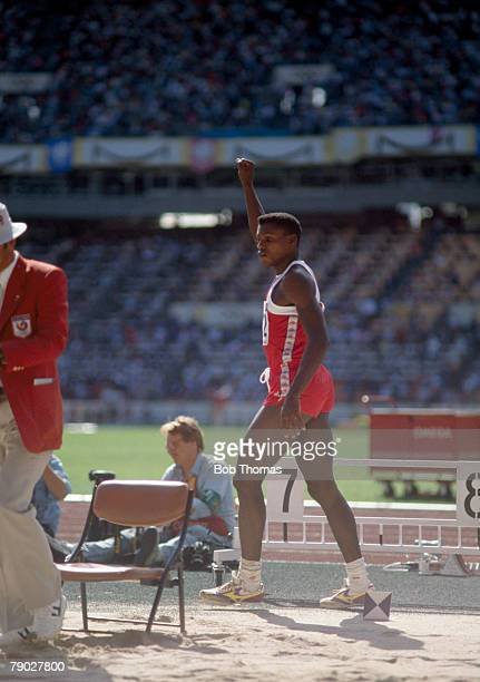 American track and field athlete Carl Lewis pictured in action to win the gold medal in the Men's long jump event at the 1988 Summer Olympics inside...