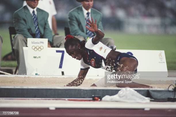 American track and field athlete Jackie Joyner-Kersee competes for the United States team during progress to finish in third place to win the bronze...