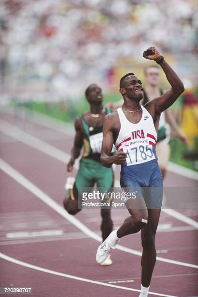 American track and field athlete Kevin Young competing for the United States team celebrates as he crosses the finish line in first place in a world...