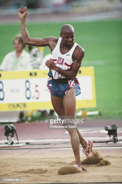 American track and field athlete Mike Powell pictured in action competing for the United States team to finish in second place to win the silver...