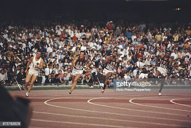 American track and field athlete Tommie Smith pictured far right in action competing for the United States team to finish first to win the gold...