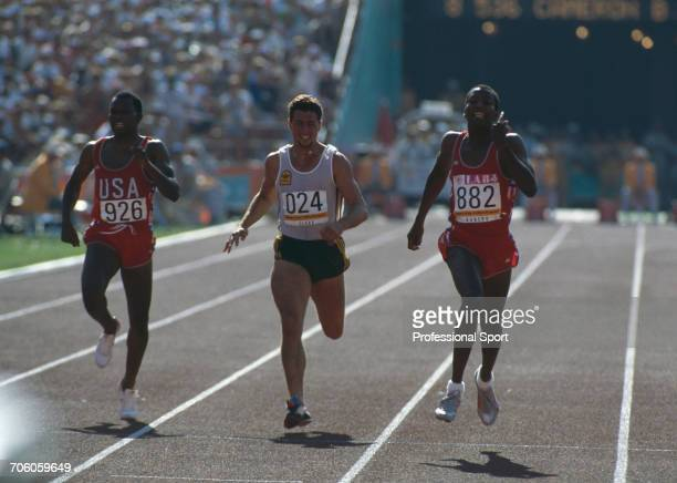 American track athlete Alonzo Babers approaches the finish line in first place to win the gold medal ahead of 4th placed Darren Clark of Australia...