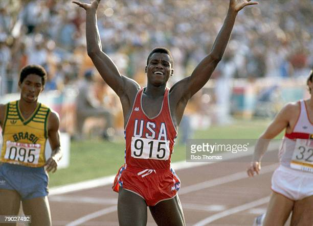 American track athlete Carl Lewis celebrates as he wins the gold medal in the final of the Men's 200 metres event inside the Memorial Coliseum at the...