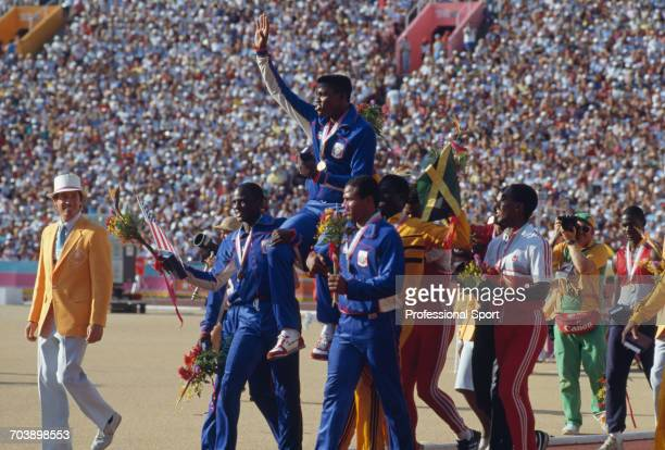 American track athlete Carl Lewis is held aloft by his teammates Sam Graddy and Ron Brown after the United States Men's 4 x 100 metres relay team...