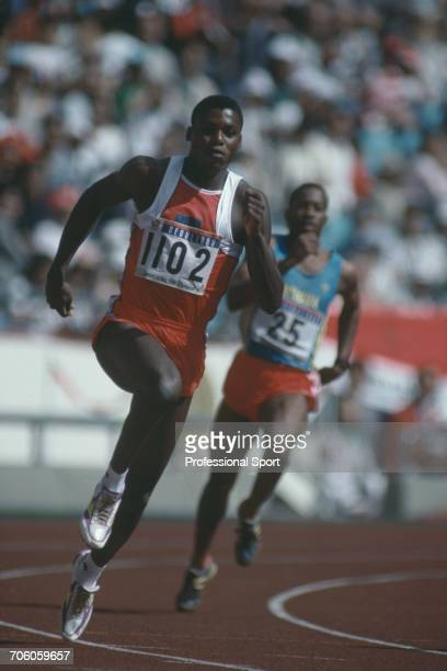 American track athlete Carl Lewis pictured in action for the United States team ahead of Howard Lindsay of Antigua and Barbuda in round one heat 10...
