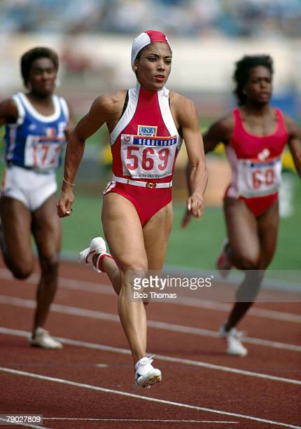 American track athlete Florence GriffithJoyner competes in the heats of the Women's 100 metres event at the 1988 Summer Olympics inside the Olympic...
