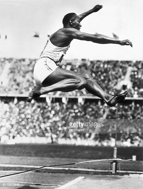 American track athlete Jesse Owens makes the long jump that set an Olympic record in Berlin at the 1936 Olympic Games His performance at the Games in...