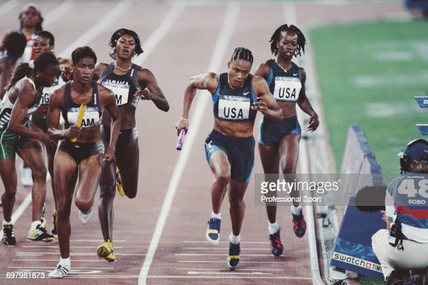 American track athlete Marion Jones pictured taking the baton from Monique Hennagan ahead of Deon Hemmings and Catherine Scott of the Jamaica team at...