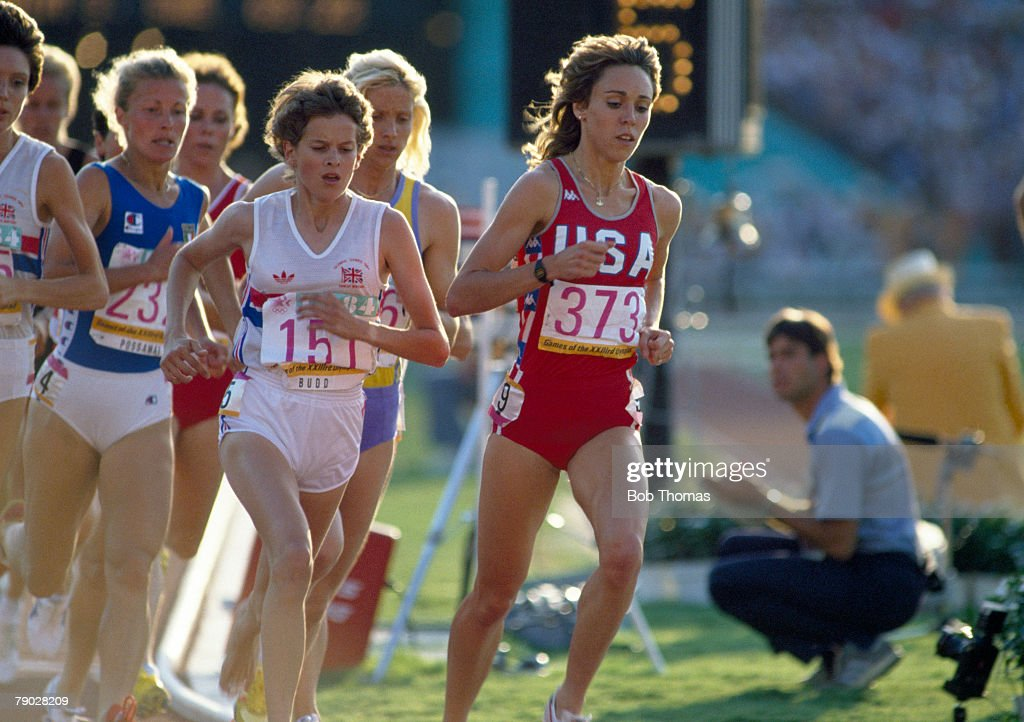 American track athlete Mary Decker leads the race followed by Zola Budd of Great Britain in the final of the Women's 3000 metres event at the 1984 Summer Olympics inside the Memorial Coliseum in Los Angeles, United States on 10th August 1984. Mary Decker would go on to fall in the race after colliding with Zola Budd on the 5th lap.