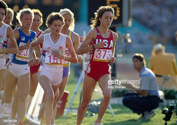 American track athlete Mary Decker leads the race followed by Zola Budd of Great Britain in the final of the Women's 3000 metres event at the 1984...
