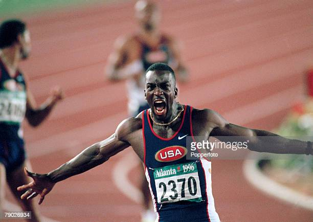 American track athlete Michael Johnson celebrates after finishing in first place in a new world record time to win the gold medal in the final of the...