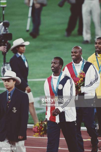 American track athlete Michael Johnson pictured leaving the medal podium after finishing in first place for the United States team to win the gold...
