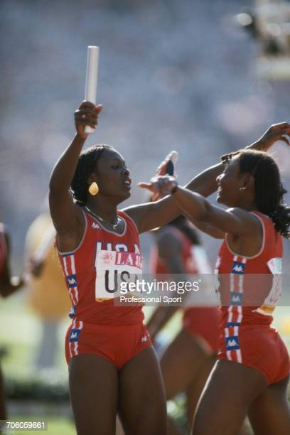 American track athletes Chandra Cheeseborough and Sherri Howard congratulate each other after the United States team finished in first place to win...