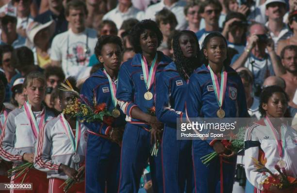 American track athletes, from left, Alice Brown, Jeanette Bolden, Chandra Cheeseborough and Evelyn Ashford of the United States team stand together...