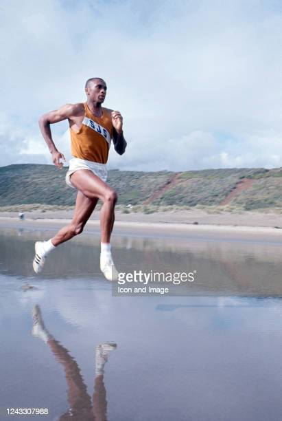 American track & field athlete, wide receiver, Olympic gold medalist and activist Tommie Smith trains on the beach, 1966.