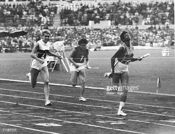 American track star Wilma Rudolph breaks the tape at the finish line as she clinches the gold medal for the women's 4 x 100m relay for the United...