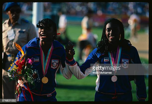 American track stars Valerie BriscoeHooks gold medal winner in the 400 meter dash and Chandra Cheesborough who won silver in the same event celebrate...