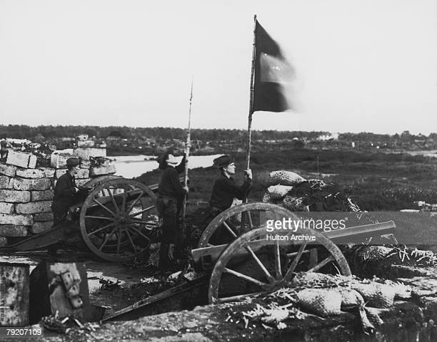 American troops at Fort Malate signal for reserves to advance after the retreat of the Spanish during the Battle of Manila in the SpanishAmerican War...