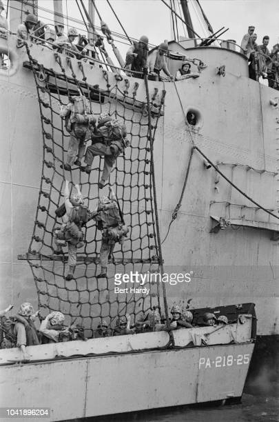 American troops climbing down scramble nets into assault craft before taking part in the Battle of Inchon, an amphibious invasion of the port city of...