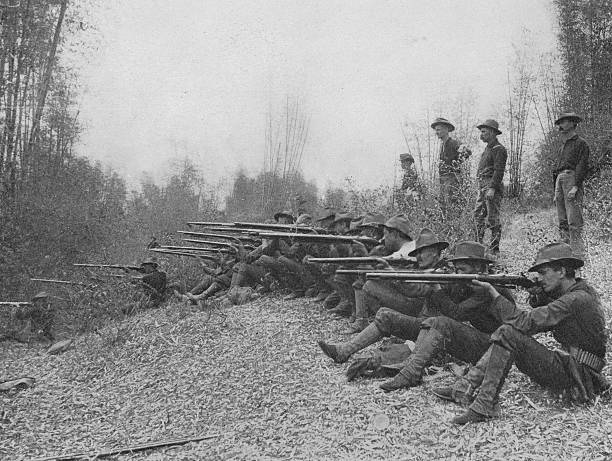 American troops fire on insurgents in the Philippine...