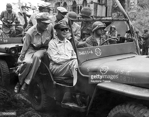 American troops have just landed on the Island of Leyte after naval combat against the Japanese General MACARTHUR who was in charge of the Allied...