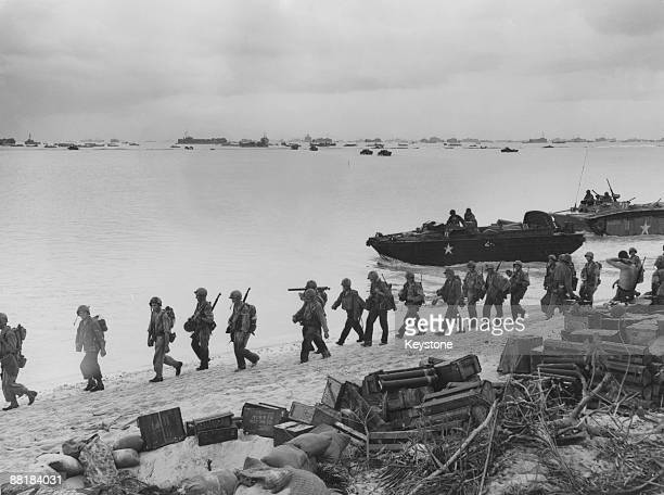 American troops land on the beaches of Saipan Island during the Battle of Saipan in the Northern Mariana Islands, June 1944. Among the landing craft...