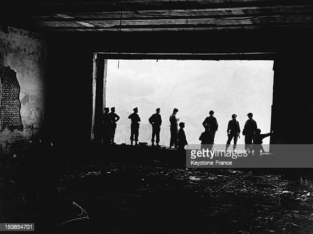 American troops looking through the huge window of the Berghof Adolf Hitler's ruined mountain house aka 'The Eagle's Nest in the Bavarian Alps on...