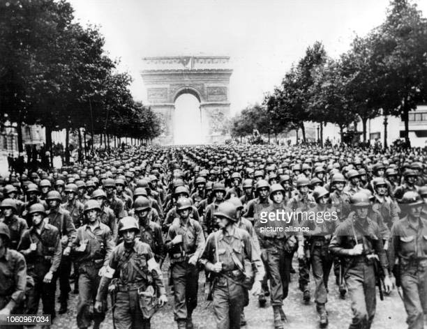 American troops march across the Champs Elysee after the liberation of the French capital in the background the Arc de Triomphe German commander...