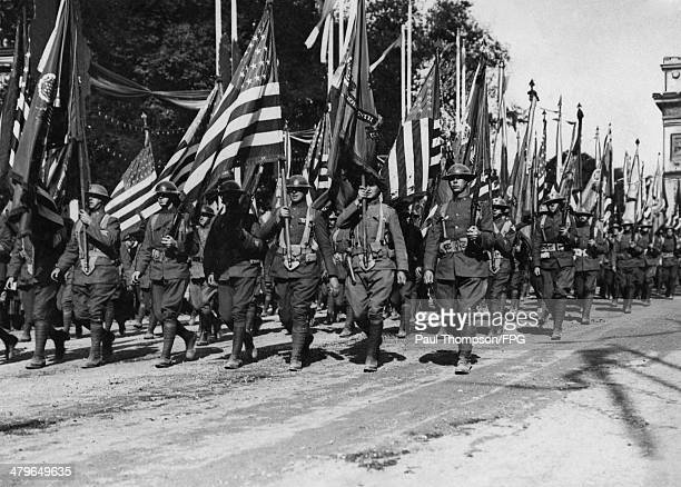 American troops march past the Arc de Triomphe in Paris in the 1919 Victory Parade of Allied troops celebrating the end of World War I 14th July 1919