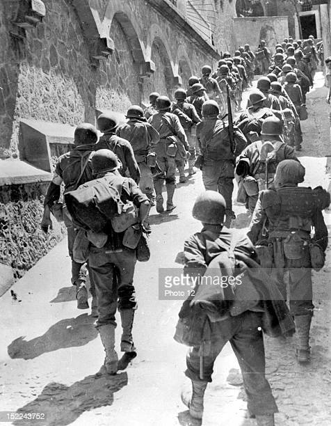 American troops march through St Angelo d'Brolo on their way to Messina