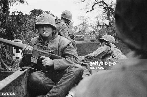 American troops on board a truck at a forward command post in the city of Hu during the Battle of Hu Vietnam War February 1968