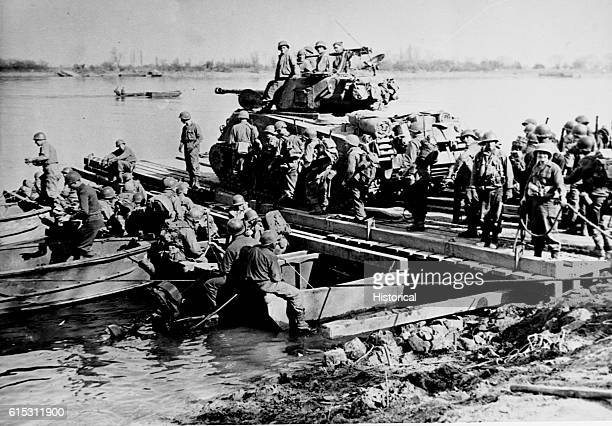 American troops prepare to cross the Rhine with a tank on a pontoon raft. Germany, 1945.