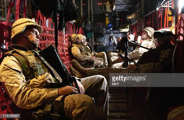 American troops take a military flight to southern Iraq where they were accompanying Maj Gen Geoffrey Miller on a visit to Camp Bucca a USrun...