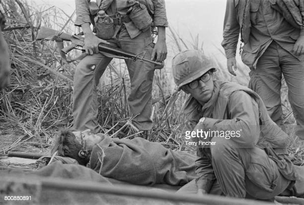 American troops tending to a casualty on Hill Timothy during an action against the Viet Cong Vietnam War April 1968