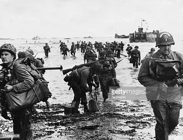 American troops wade on one of four beaches in Normandy, France, on June 7 the day after D-Day. The landing was part of an all-out Allied assault on...