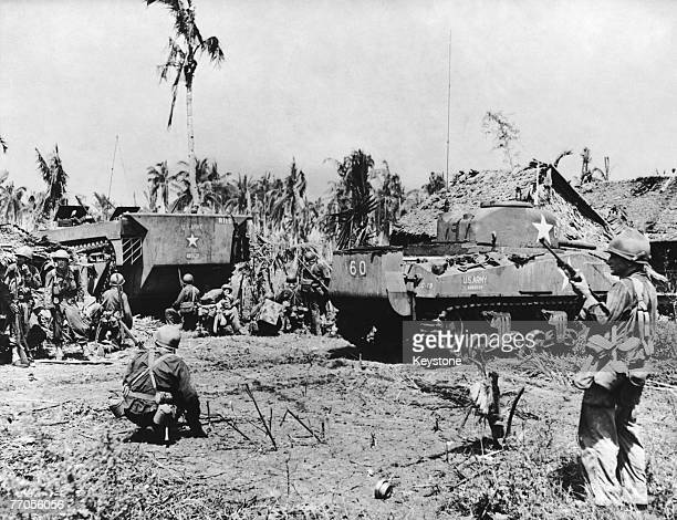 American troops with a Sherman tank in a village in Leyte province in the Philippines during the Battle of Leyte 30th October 1944 The battle ended...