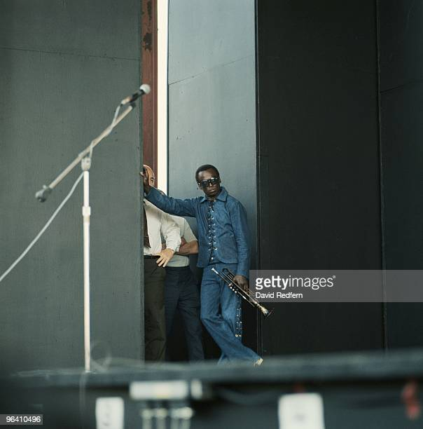 American trumpeter and composer Miles Davis posed at the side of the stage at the Newport Jazz Festival at Newport, Rhode Island, 5th July 1969....