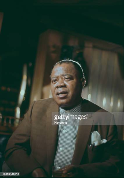 American trumpeter and singer Louis Armstrong at the Mayfair Hotel in London circa 1960