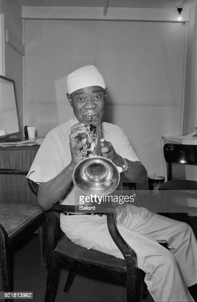 American trumpeter, composer and singer Louis Armstrong at the Hammersmith Odeon on his 68th Birthday, London, UK, 4th August 1968.