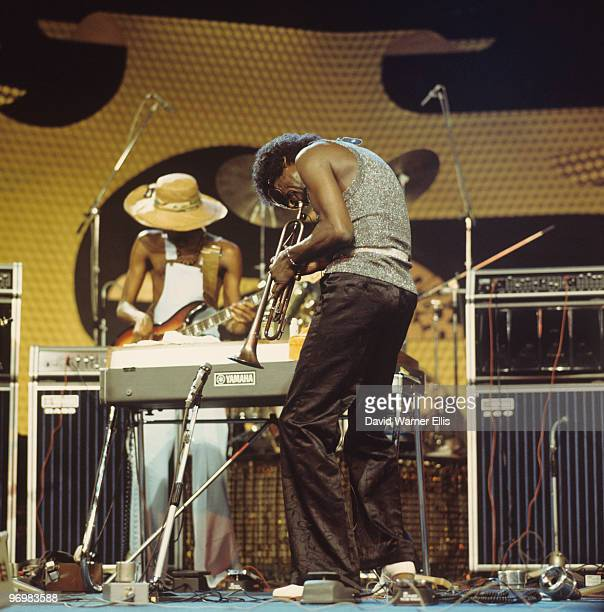 American trumpeter Miles Davis performs on stage with bassist Michael Henderson at the Montreux Jazz Festival held in Montreux Switzerland on July 08...