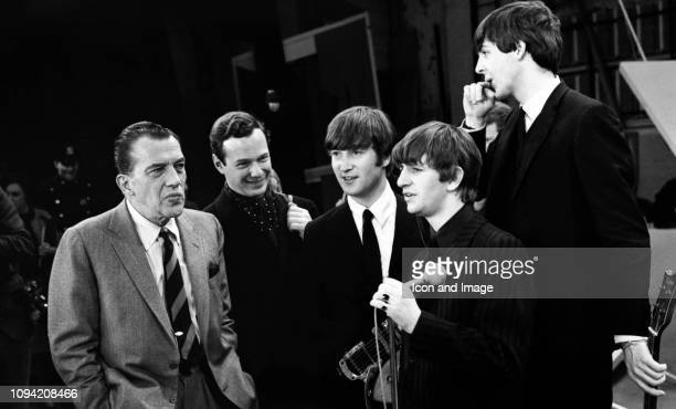 American TV host Ed Sullivan talks to English manager Brian Epstein English singer songwriter and guitarist John Lennon English singer and drummer...