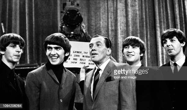 American TV host Ed Sullivan talks to English musician singer and drummer Ringo Starr English musician singersongwriter and guitarist George Harrison...